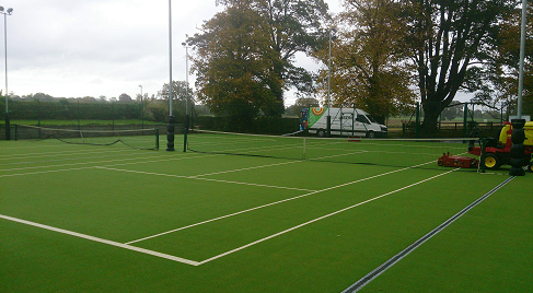 maintenance machine on astro turf tennis courts